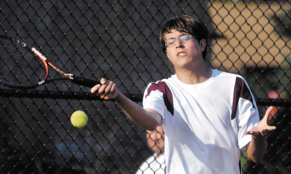 Alexandria's RJ Sizelove returns a shot in his #2 singles match with Frankton in the first round of the boys tennis sectional.