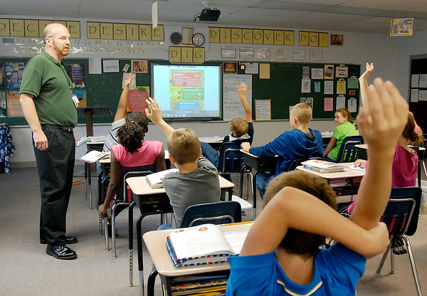 Teacher Eric Barnes asks his 5 & 6 grade students questions as they go through their geology lesson Wednesday afternoon at Indiana Christian Academy.