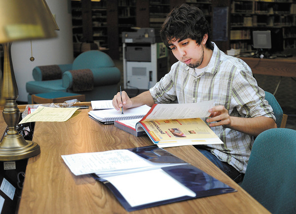 Nathan Nieman of Anderson studies Spanish at the Nicholson Library as classes for the fall semester at Anderson University started on Tuesday.