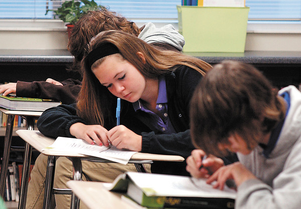 Success Academy 8th grader Shelby Snyder works on her English assignment.