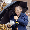 Betty Schulte, of Anderson, keeps her food dry as a light rain fell at Octoberfest Friday afternoon.