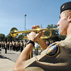 ROTC cadet Ensign Collin Pratt plays taps during a 9/11 ceremony at Anderson High School put on by the ROTC unit of the school.