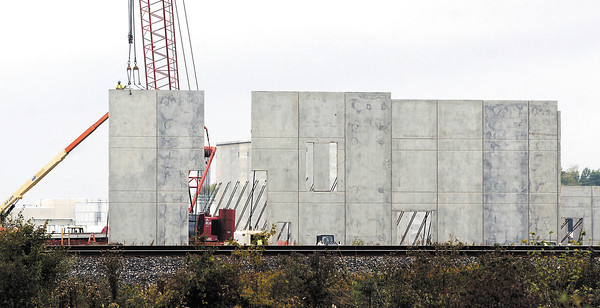 Greenville Technology Inc.'s 150,000 square-foot auto parts manufacturing facility takes shape as workers erect preformed wall sections at the Flagship Industrial Park site Wednesday.  Construction was started in late July with operations to start in the new plant in January.