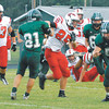 Pendleton Heights junior Jim Arney brings the ball downfield for the Arabians.
