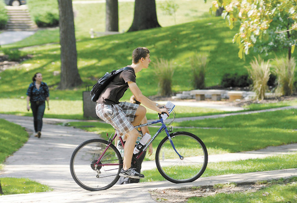 A student rides his bike across the valley as classes for the fall semester at Anderson University started on Tuesday.