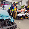The driver of this car gets transported to the hospital after crashing her vehicle in the 1000 block of West Third Street in Anderson while being pursued by Madison County Sheriff's deputies Friday afternoon.