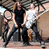 Lead singer Josh Bramlett and guitarist TJ Collwell from the Christian rock band The Protest start headbanging as they perform during the Walking Manifestival downtown on Saturday.