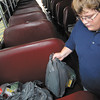 Mathew Wade, 14, loads up another seat with school supplies during Saturdays' Help Fill the Bus drive at Wal-Mart.