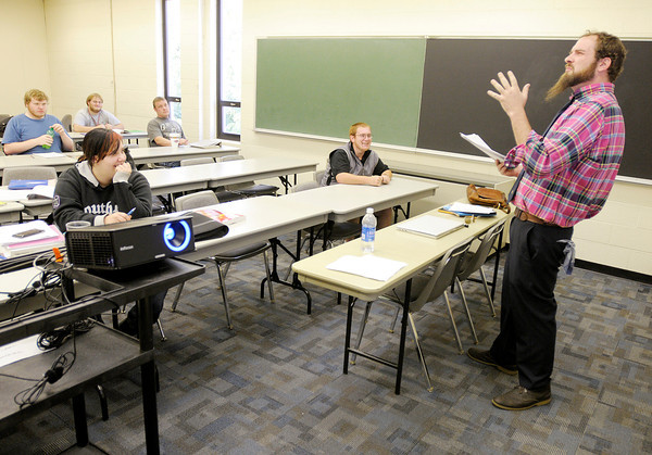 Mathew Stevens teaches a first year seminar class at Ivy Tech's 38th street location on Wednesday.  Ivy Tech graduation rates have been on the rise.