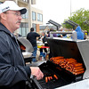 John Humes mans the grill keeping the brats and hot dogs coming at Octoberfest Friday.