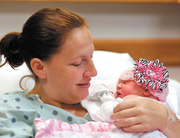 Carrie Lamb smiles as she holds her new baby daughter Caitlyn.