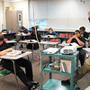 Language Arts teacher Joe Melo goes over essays with his students in the Success Academy at Highland Middle School.