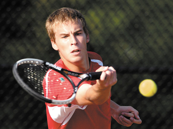 Frankton's Aaron Korn returns a shot in his #1 singles match with Alexandria in the first round of the boys tennis sectional.