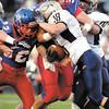 Elwood's Bobby Harrell and Drew Wells put the hit to Oak Hill's fullback Kegan Anderson in first half action.