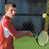 Frankton's Conner Bates returns a shot in his #3 singles match with Alexandria in the first round of the boys tennis sectional.