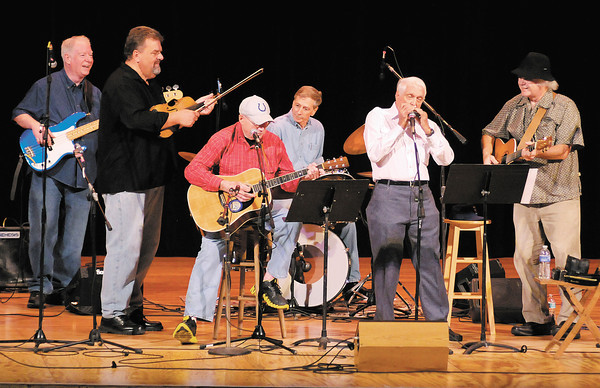 From left, Henry Connelly, Jeff Hardin, John Gunter, Mark Maynard, Carl Erskine, and Dan Daughtery perform during the Little Bit Country Jamboree at the Paramount Theater on Thursday. Also performing on stage but not pictured was Mike McDonald. Proceeds from the event, which is in it's 23rd year, support the Madison County Special Olympics.