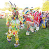 Dancers enter the arena during the the grand entry at the Andersontown Powwow at Athletic Park on Saturday. The Powwow continues today.