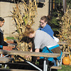 Miranda Smith, Kylie Finney, and Myranda Beach, 8th graders from APA, decorate the lawn of the Anderson Center for the Arts Tuesday evening for the Center's upcoming Octoberfest this Friday.