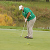 Morgan Nadaline watches her putt roll toward the cup at the golf state finals.
