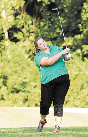 Anderson's Morgan Nadaline watches her tee shot on the par three number seven at Grandview as Anderson faced Lapel on Wednesday.