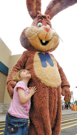 5 year old Lizzie Ferrell looks up at the Nestle Quik Bunny who was out greeting kids at the Help Fill the Bus drive that was held at the Anderson Wal-Mart Saturday.