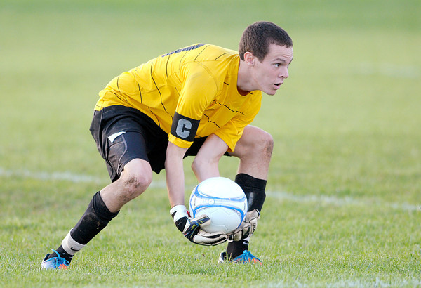 Pendleton Heights goalie Tyler Eby grabs the ball as the Arabians hosted the Anderson Indians on Wednesday.