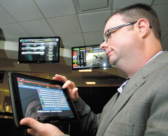 Gene Ciscell, Hoosier Park Racing & Casino Director of Information Technology, demonstrates the FastBet Mobile wagering application that enables guests to place wagers directly from their smartphones, iPads, and tablets.