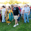 Veterans follow the flag into the arena during the grand entry at the Andersontown Powwow at Athletic Park on Saturday. The Powwow continues today.