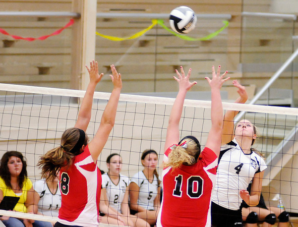 Daleville's Meredith Witty attacks over the block of Frankton's Hannah Rogers (8) and Kaylee Irwin (10) as the Broncos hosted the Eagles on Tuesday.
