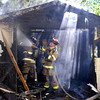 Anderson firefighters battled a unattached garage fire behind 2010 E. 5th St. Wednesday morning.
