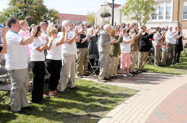 Don Knight/The Herald Bulletin<br /> Participants stand and applaud for the camera as United Way kicked off their annual campaign with a video shoot at Town Center Park on Tuesday.