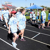 Don Knight/The Herald Bulletin<br /> Walkers complete their first lap on the track at Highland Middle School during the St. Vincent de Paul Walk for the Poor fundraiser on Saturday.