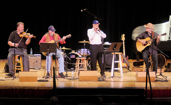 Don Knight/The Herald Bulletin<br /> From left, Jeff Hardin, John Gunter, Carl Erskine and Dan Daugherty perform during the Little Bit Country Jamboree at the Paramount on Thursday. The annual concert is a fundraiser for Special Olympics.