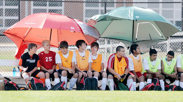 Don Knight/The Herald Bulletin<br /> Anderson's soccer team finds some relief from the heat in the shade of umbrellas as the Inidans hosted the Pendleton Heights Arabians on Wednesday. Read about the outcome of the game on today's B1.