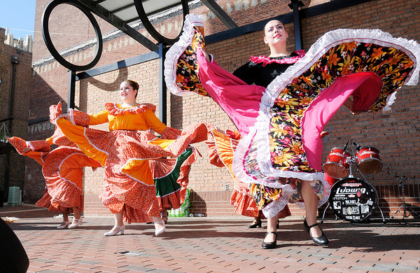 Don Knight/The Herald Bulletin<br /> Anderson's Ballet Folklorico performs on stage at the Town Center Park during the Anderson Fiesta on Saturday. The event included several bands, food and vendors.