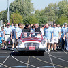 Don Knight/The Herald Bulletin<br /> Monsignor Robert Sell, seated at right, leads the start of the St. Vincent de Paul Walk for the Poor fundraiser at Highland Middle School on Saturday.