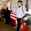 Members of the Veterans of Foreign Wars Post 266 Honor Guard stand guard next to their fallen commander Herbert LaShure at Robert D. Loose Funeral Home Monday for his visitation and service.  LaShure, who passed away Sept. 17, had been involved in the honor guard for nearly 30 years.