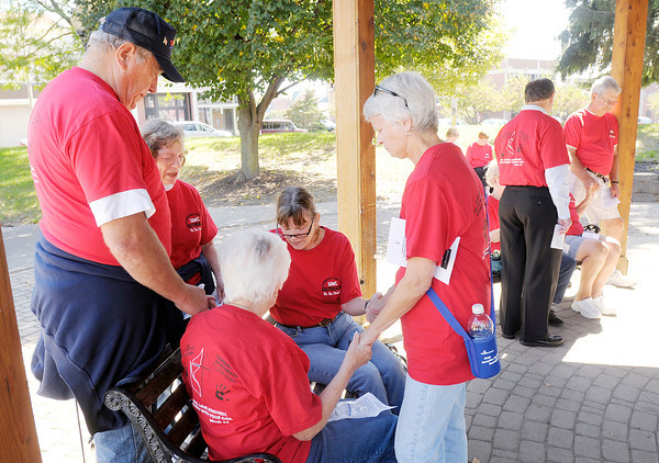 Don Knight/The Herald Bulletin<br /> Members from seven Methodist churches gather for prayer downtown after a morning of service projects in the community.