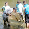 Don Knight/The Herald Bulletin<br /> With direction from Professor Dan Ippolito Anderson University honor students collect invertebrates from the White River as they conduct an assessment of the water way on Wednesday.