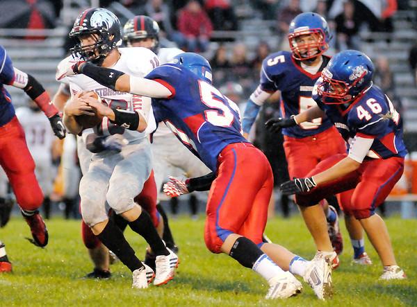 Don Knight/The Herald Bulletin<br /> Elwood's Derek Bryant tackles Eastbrook quarterback Jacob Singer on Friday.