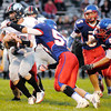Don Knight/The Herald Bulletin<br /> Elwood's Derek Bryant tackles Eastbrook quarterback Jacob Singer on Friday.