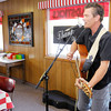 Don Knight/The Herald Bulletin<br /> Matt Cookman plays a mix of covers and his own songs on acoustic guitar at Greeks Pizzeria in Anderson on Wednesday.