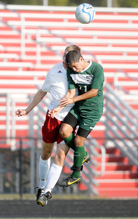 """Don Knight/The Herald Bulletin<br /> Anderson's Stuart """"Wesley"""" Erny and Pendleton Heights' Nick Ortega collide as they jump in the air to head the ball as the Indians hosted the Arabians on Wednesday."""
