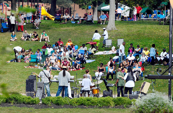 People spread out up and down the hill in Shadyside Park to listen to Toy Factory play during the Labor Day Bash Monday afternoon.
