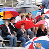 Don Knight/The Herald Bulletin<br /> Elwood fans stay dry under umbrellas as a cold front brought rain showers to the area on Friday. The forecast for the weekend look great with cooler temperatures and sunny skies.