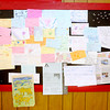 Don Knight/The Herald Bulletin<br /> A bulletin board includes several notes written in crayon by customers singing the praises of the pizza at Greeks Pizzeria in Anderson.