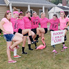 Liberty Christian School volleyball team members flock the yard of athletic director Jason Chappell Tuesday evening to raise money to donate to a Liberty family that is battling breast cancer.
