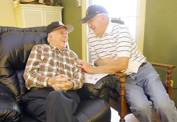 Don Knight/The Herald Bulletin<br /> Norm Hathcoat, right, visits with his brother Bernie at Miller's Merry Manor in Middletown on Monday. Miller's has a five star rating.