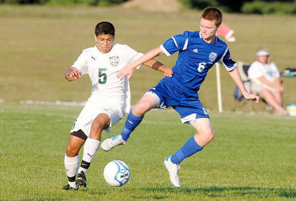 Don Knight/The Herald Bulletin<br /> Pendleton Heights' Mateo Ortega and Hamilton Southeastern's Liam Kane fight for control of the ball as the Arabians hosted the Royals on Thursday.