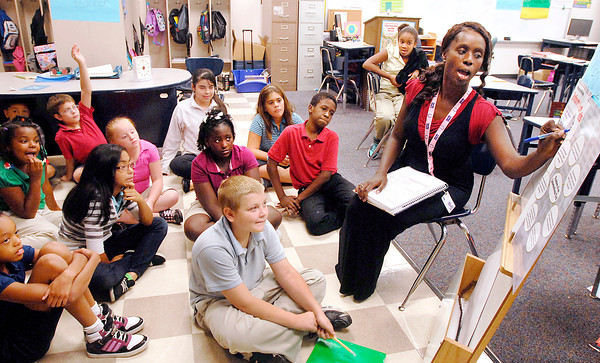 Anderson Elementary School teacher Catrina Cooper goes over a lesson on informational texts with her 5th grade students Monday afternoon.